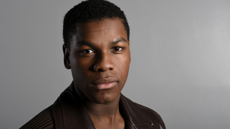 """In this Sunday, Dec. 6, 2015 photo, actor John Boyega poses for a photo during a promotion for the new film, """"Star Wars: The Force Awakens,"""" in Los Angeles. Boyega stars as Finn in the J.J. Abrams directed movie that opens in U.S. theaters on Dec. 18, 2015. (Photo by Jordan Strauss/Invision/AP)"""